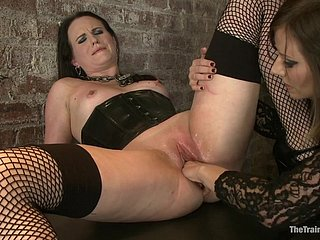 Domina fists a submissive slut and vibes her vagina to intense climax