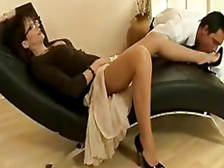 Titillating grown up floozy in nylons with an increment of heels teases a young stud